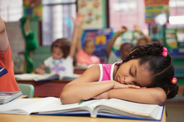 Girl sleeping in class