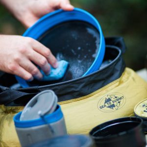 Always wash your dishes in a portable sink with biodegradable soap to protect the environment. Portable sink and camp soap available at Wilderness Supply