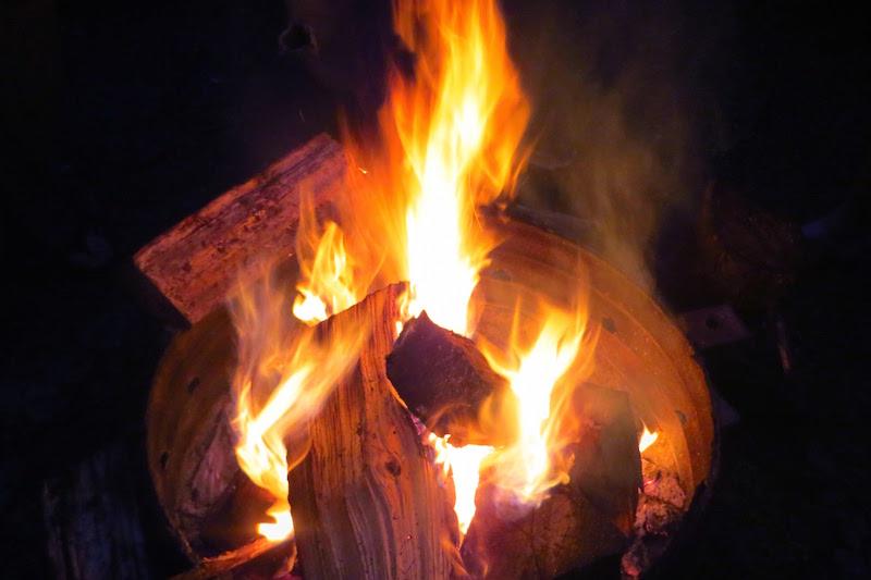 Enjoying a nighttime campfire in Riding Mountain National Park. Photo: Buffy Cowtan