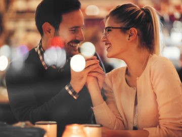 Romantic couple dating at night in pub