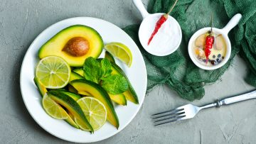 fresh avocado, lime and spice on a table