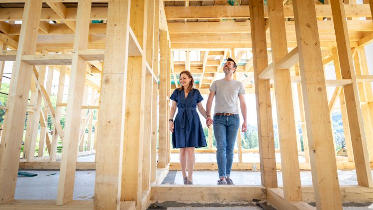Loving couple at construction site of their new home dreams come true