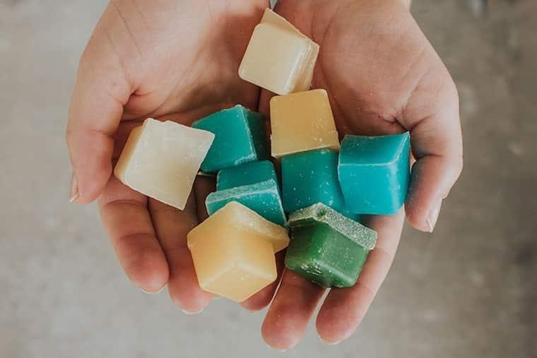 hands-holding-wax-melts-min
